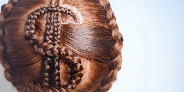 pigtails braided in the form of a dollar sign, original hairstyle, hair drawing, texture, close-up, shape